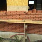 Стены из сип панелей отделываем кирпичом